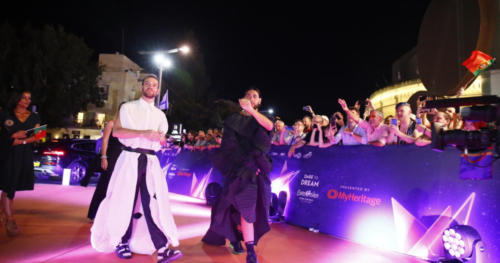Conan Osiris from Portugal waving to fans at the Orange Carpet