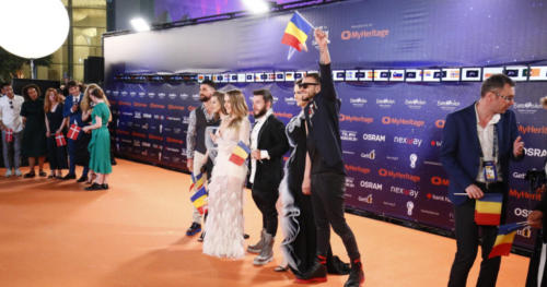 Ester Peony (Romania) making her entrée on the Orange Carpet