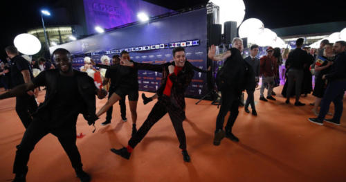 Luca Hänni (Switzerland) showing off his dance moves on the Orange Carpet