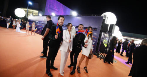 Srbuk from Armenia waving flags on the Orange Carpet